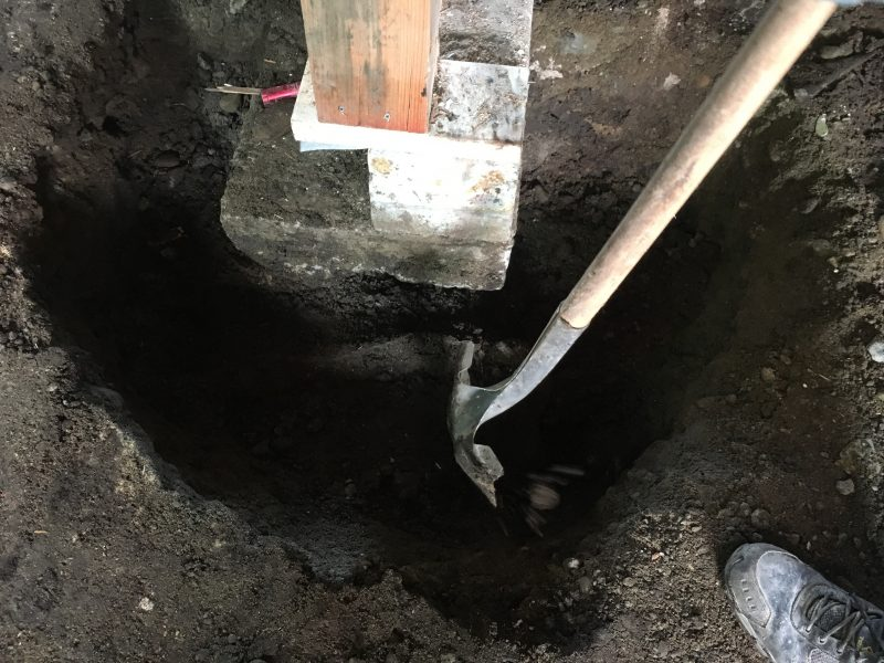 Shovelling a hole for repair
