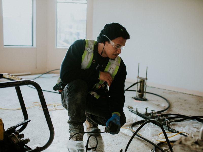 Staff during foundation repair indoor