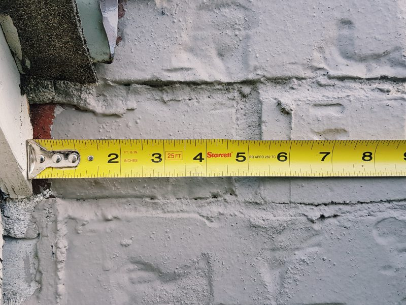 Measuring tape against the wall